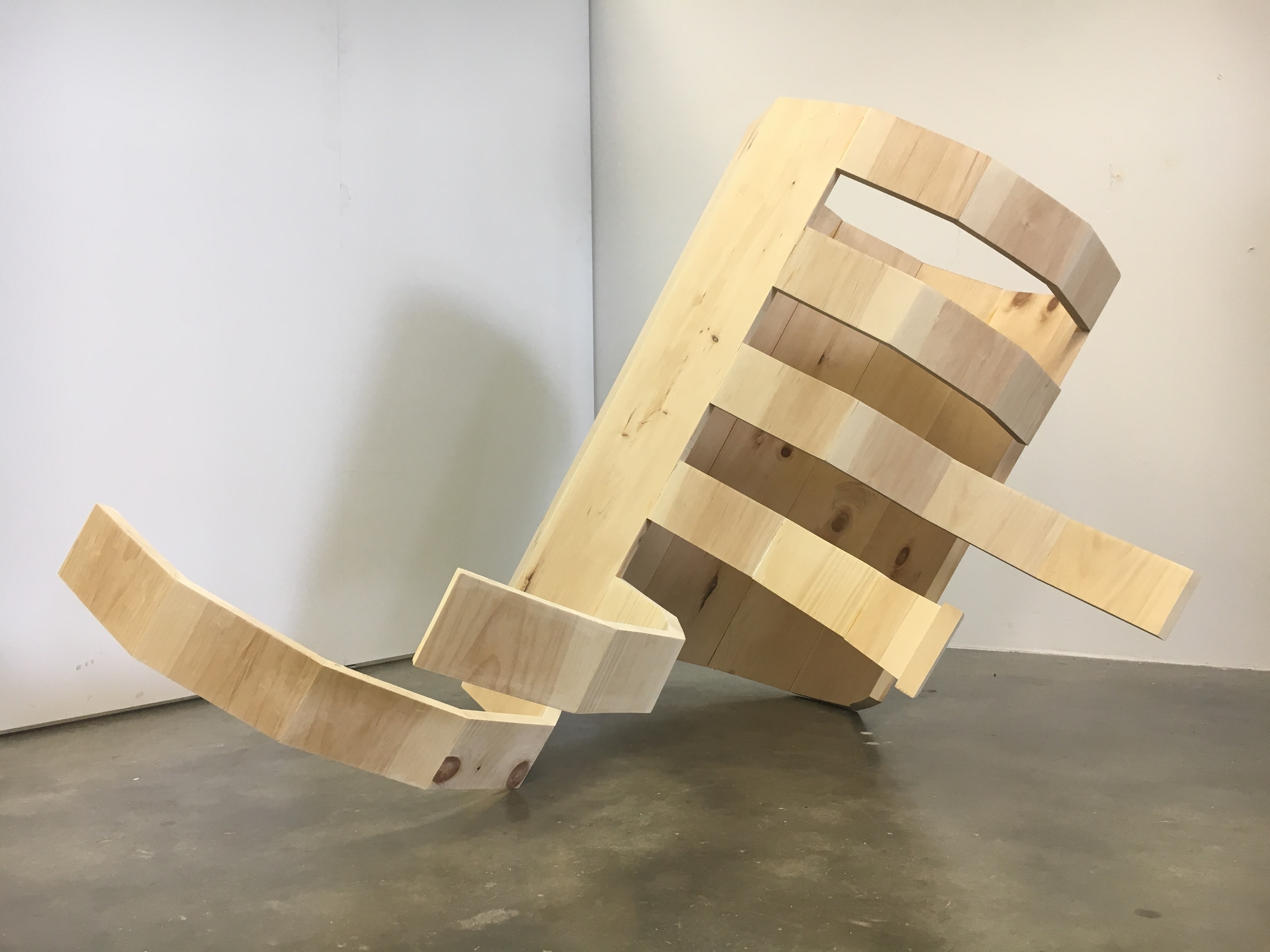 Wooden sculpture of an organic bending form