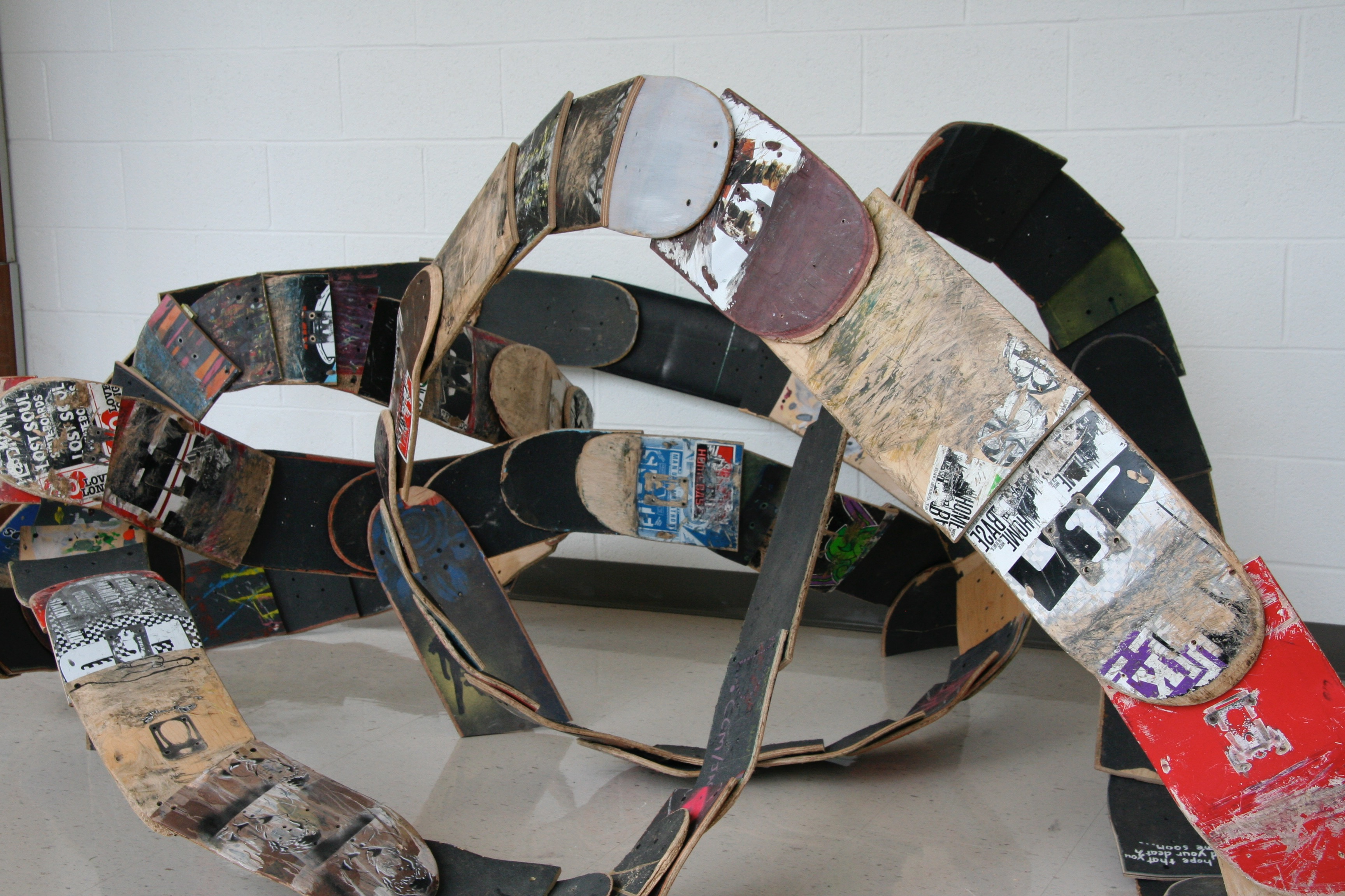 Sculpture of cut metal sheets collaged with paper