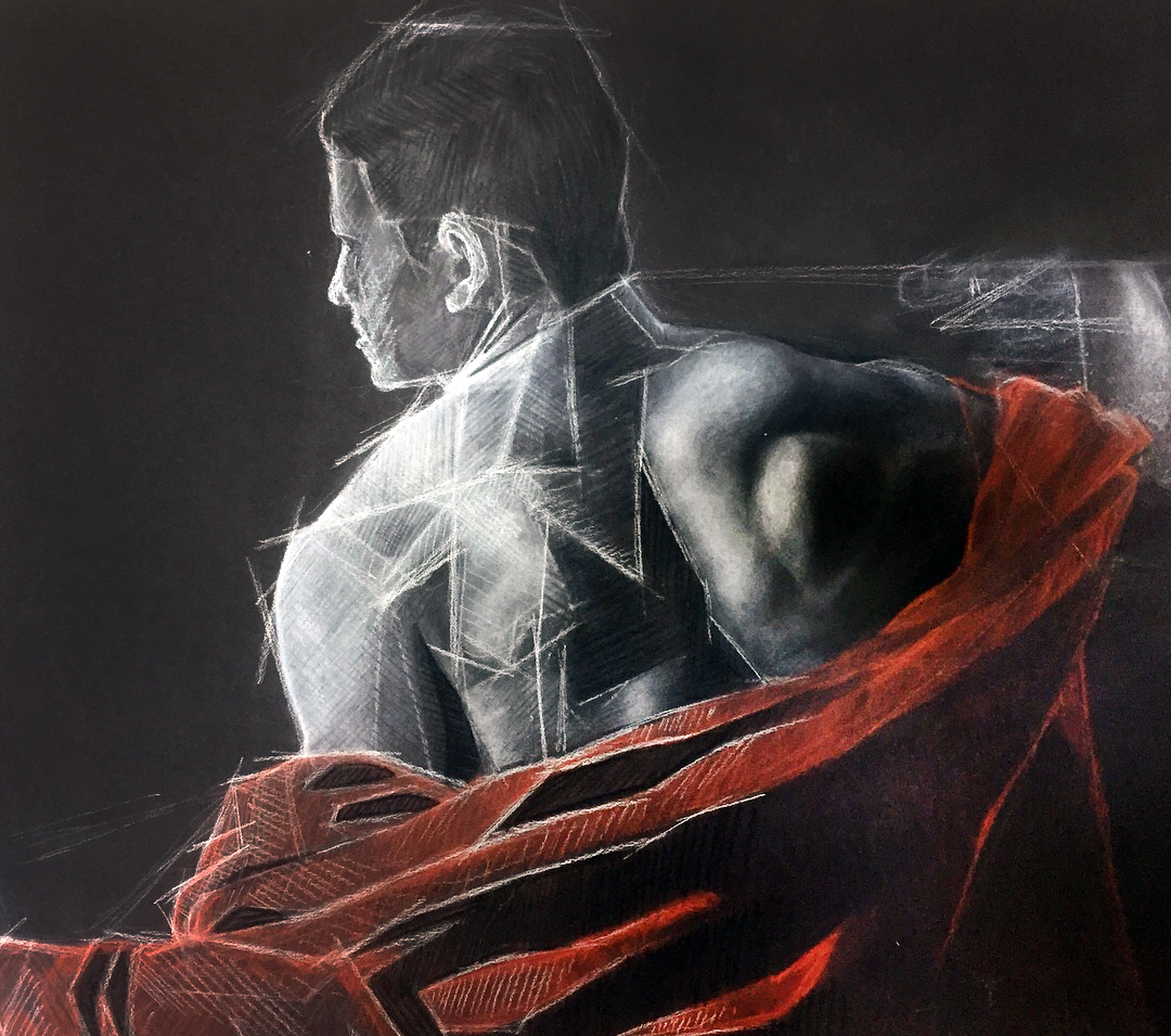 White charcoal drawing on black paper of a male figure with a red cloth