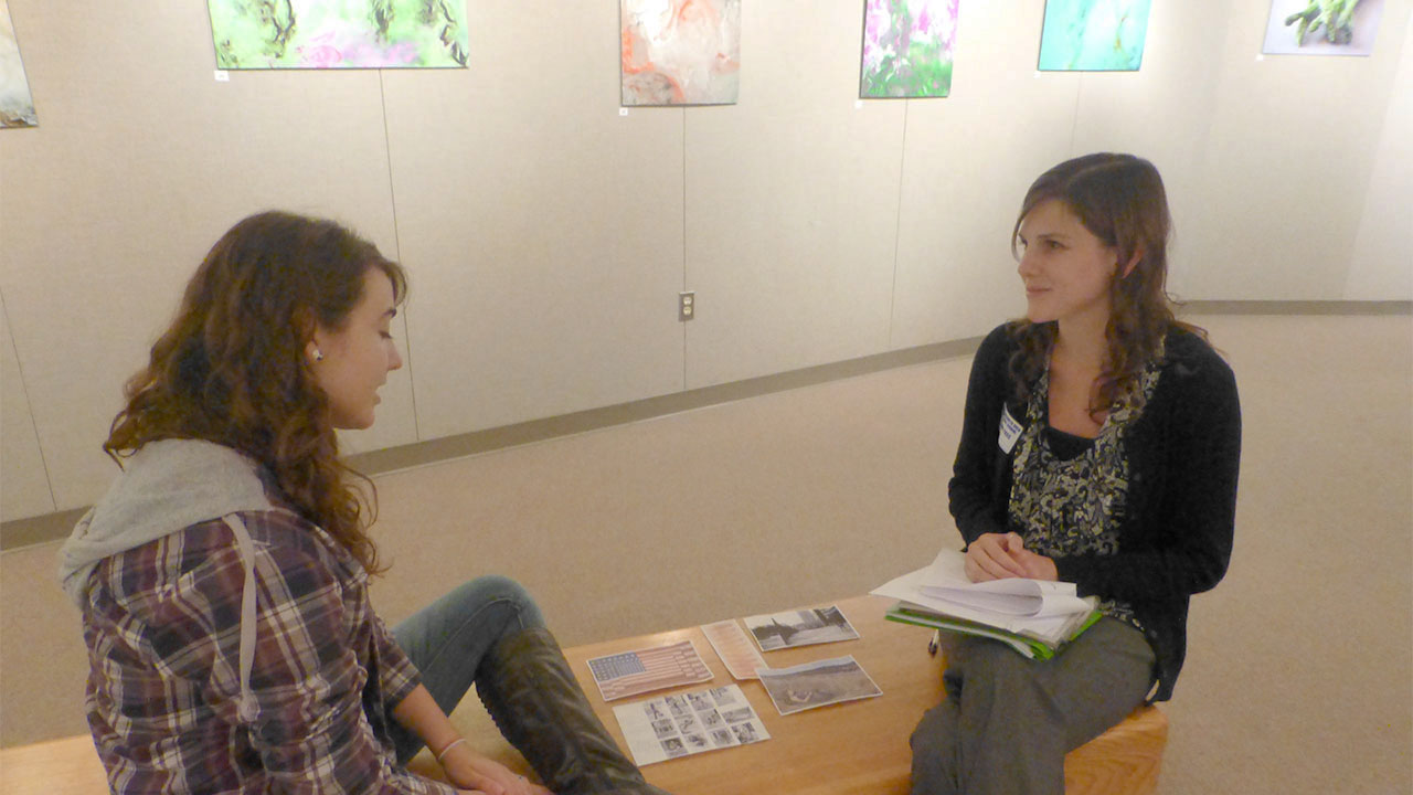 two students studying in a agallery