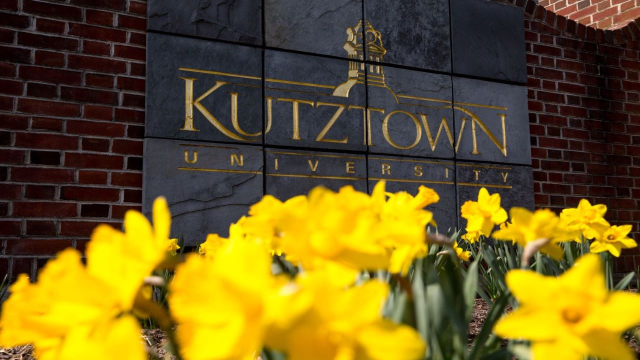 Kutztown Sign with Daffodils