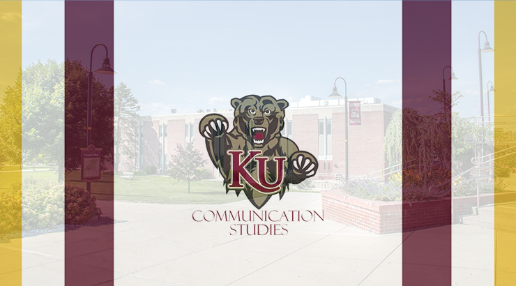 KU Bear logo with a building in the background
