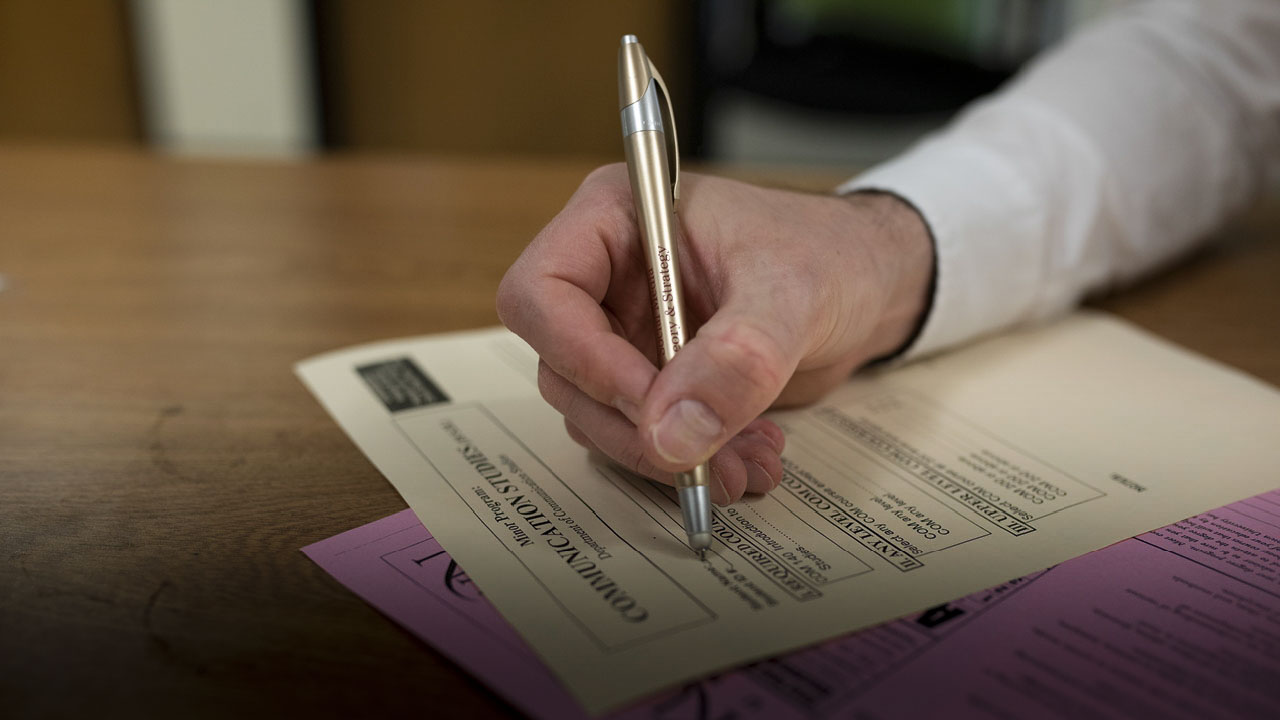 Person filling out documents
