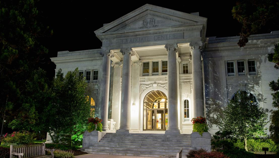 Graduate Center entrance at night.