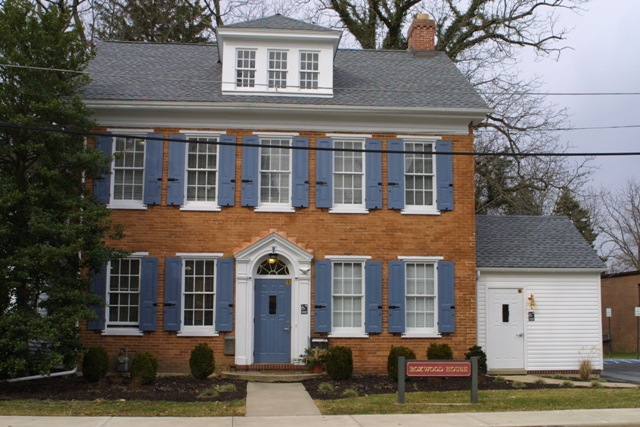 Photo of Boxwood House Red Brick Light Blue Shutters