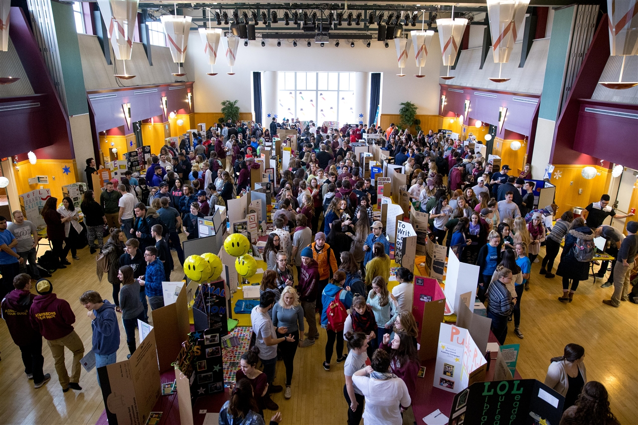Overhead view of Kutztown Involvement Fair with tables for different student organizations set up around the Multipurpose Room in McFarland Student Union Building