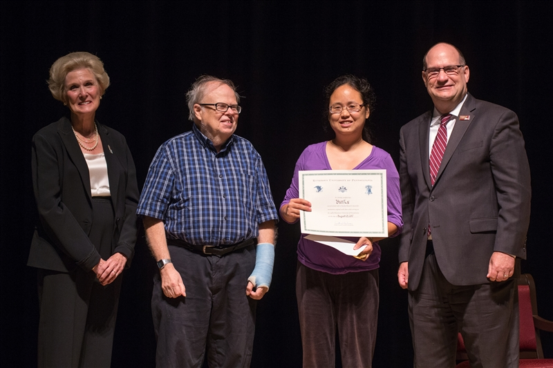 Dr. Lu being presented with the Chambliss Faculty Research Award