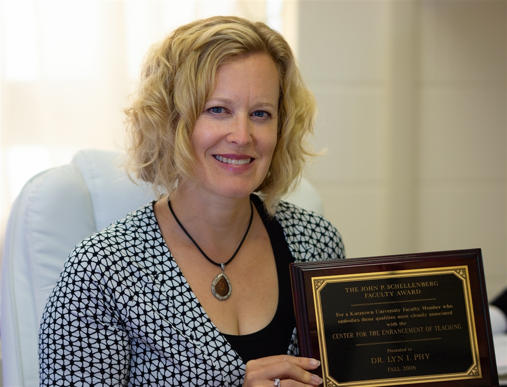 Dr. McQuaid posing with her award