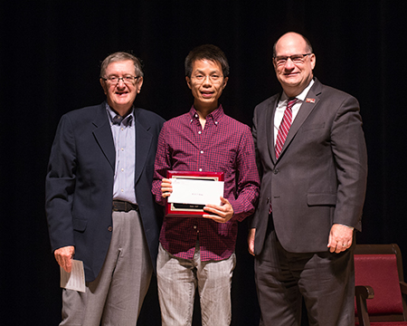 Dr. Wong is presented with the Schellenberg Award