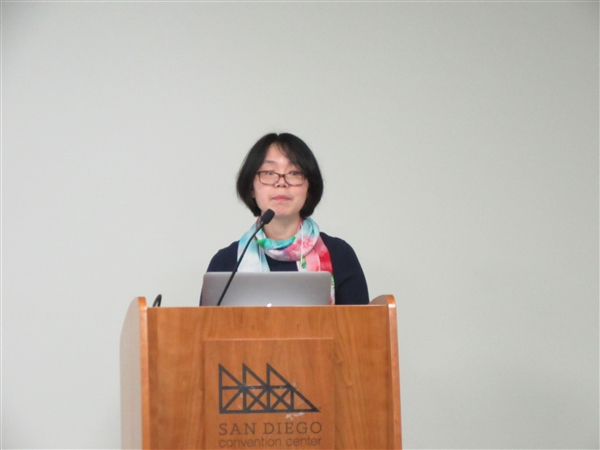 Faculty member presenting at a conference