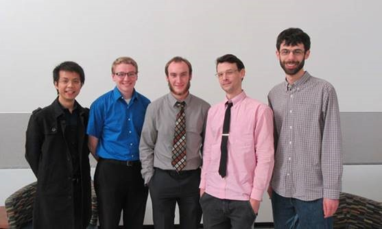 Student presenters with faculty mentors at a conference