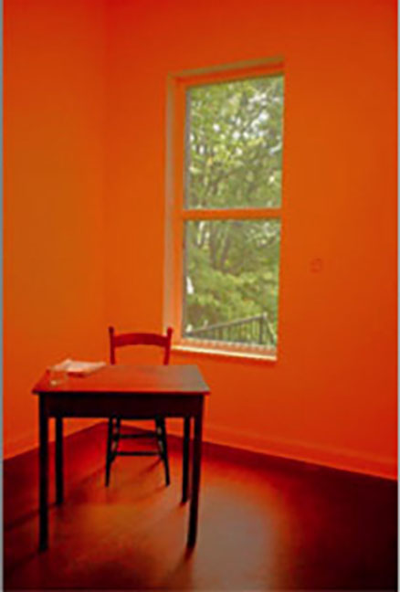 A image of a room, with a chair and a table