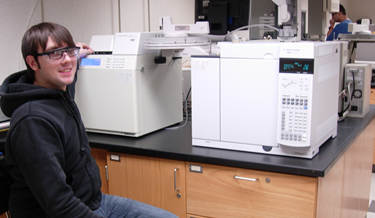Student in front of the Agilent 7890A gas chromatograph