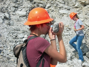 Geology student in hard hat in the field