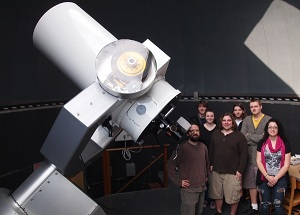 Dr. Reed and students with telescope.