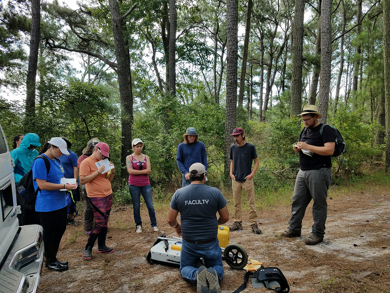 Students in the maritime forest with GPR