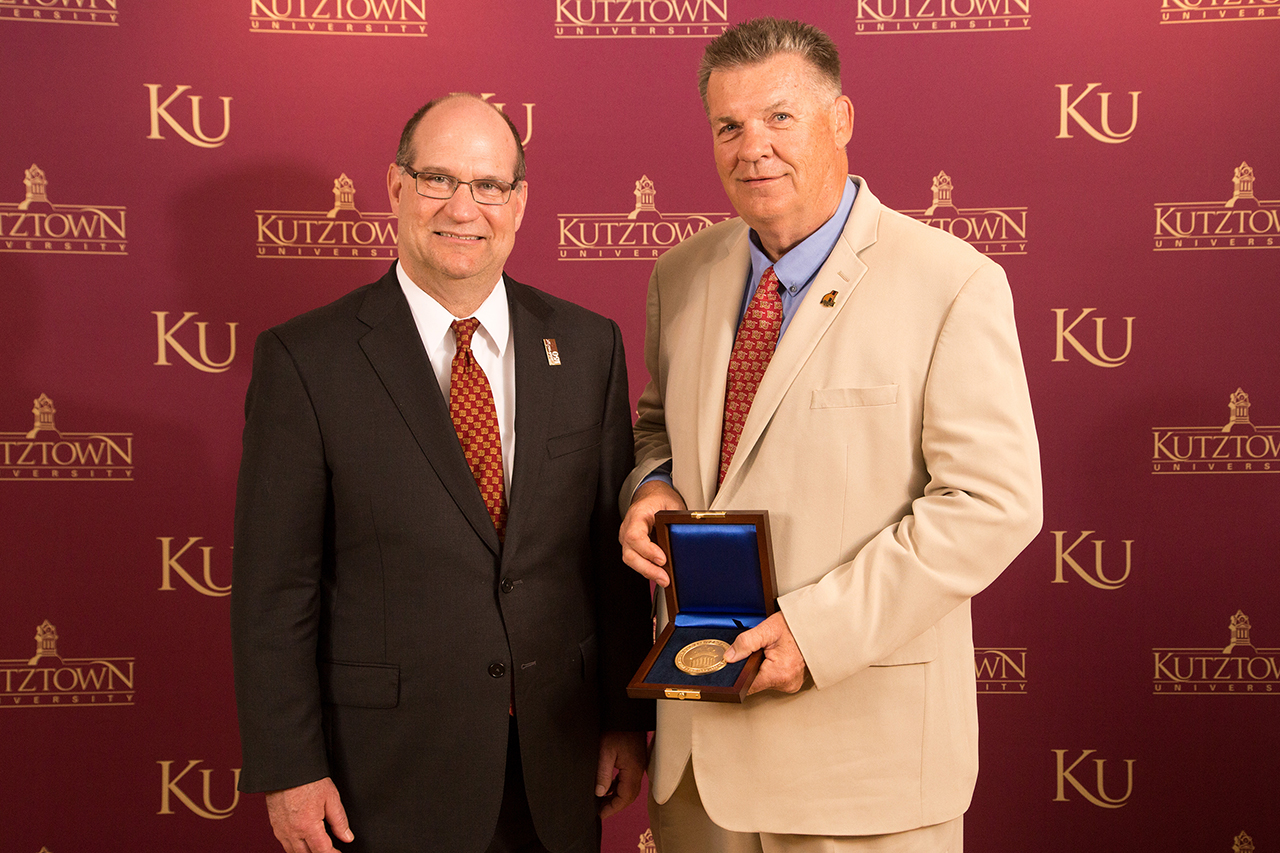 Dr. Kenneth Hawkinson (left) presenting presenting Dr. Gregory A. Jones (right) with the Kutztown University President's Medal