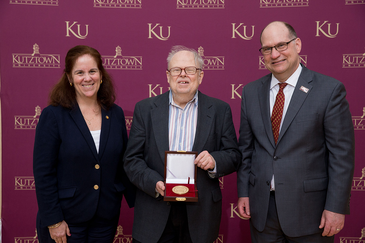 Dr. Anne Zayaitz (left) and Dr. Kenneth S. Hawkinson (right) presenting Dr. Carlson Chambliss (center) with the Kutztown University President's Medal.