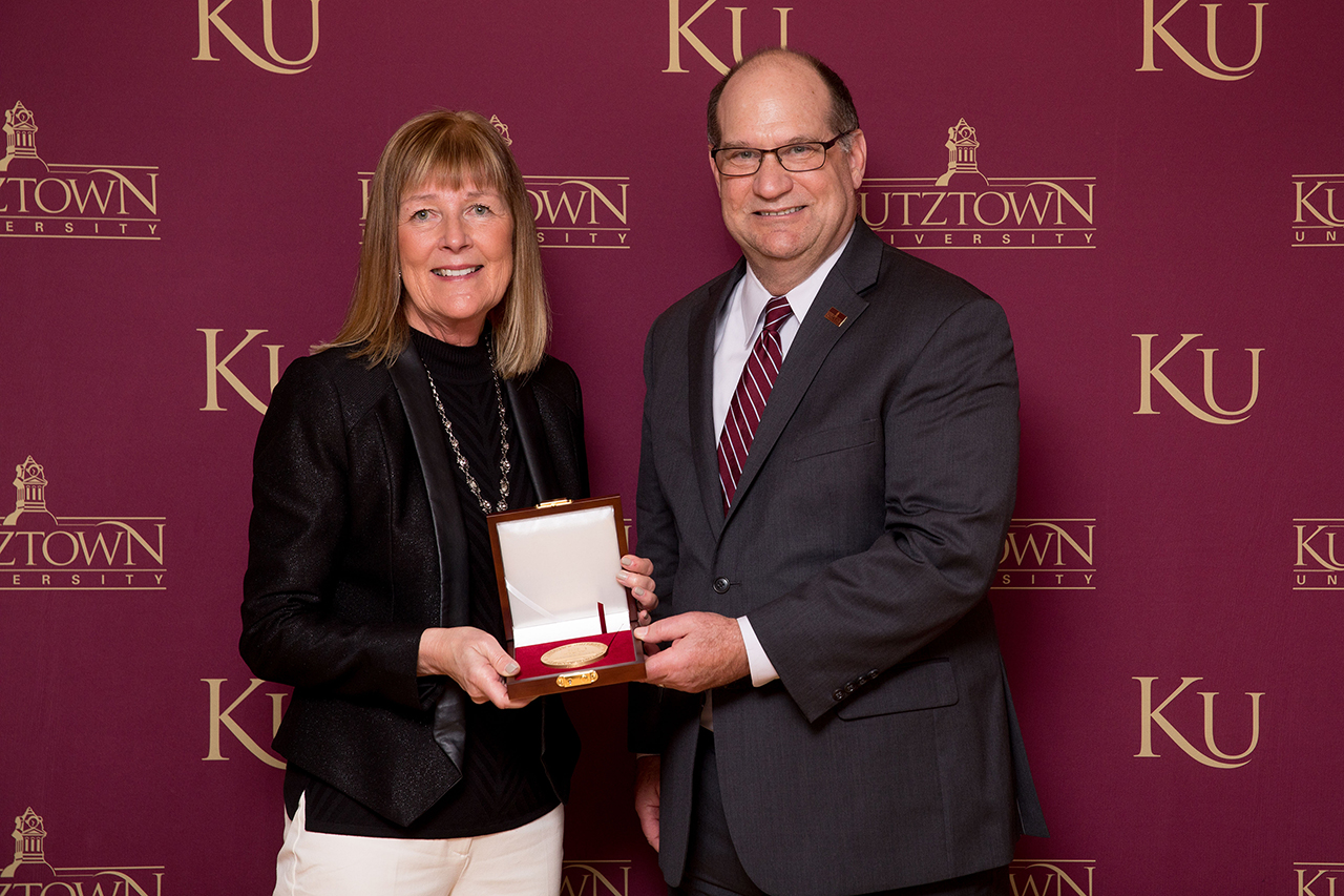 Dr. Kenneth S. Hawkinson (right) presenting Mayor Sandra Green (left) with the Kutztown University President's Medal.