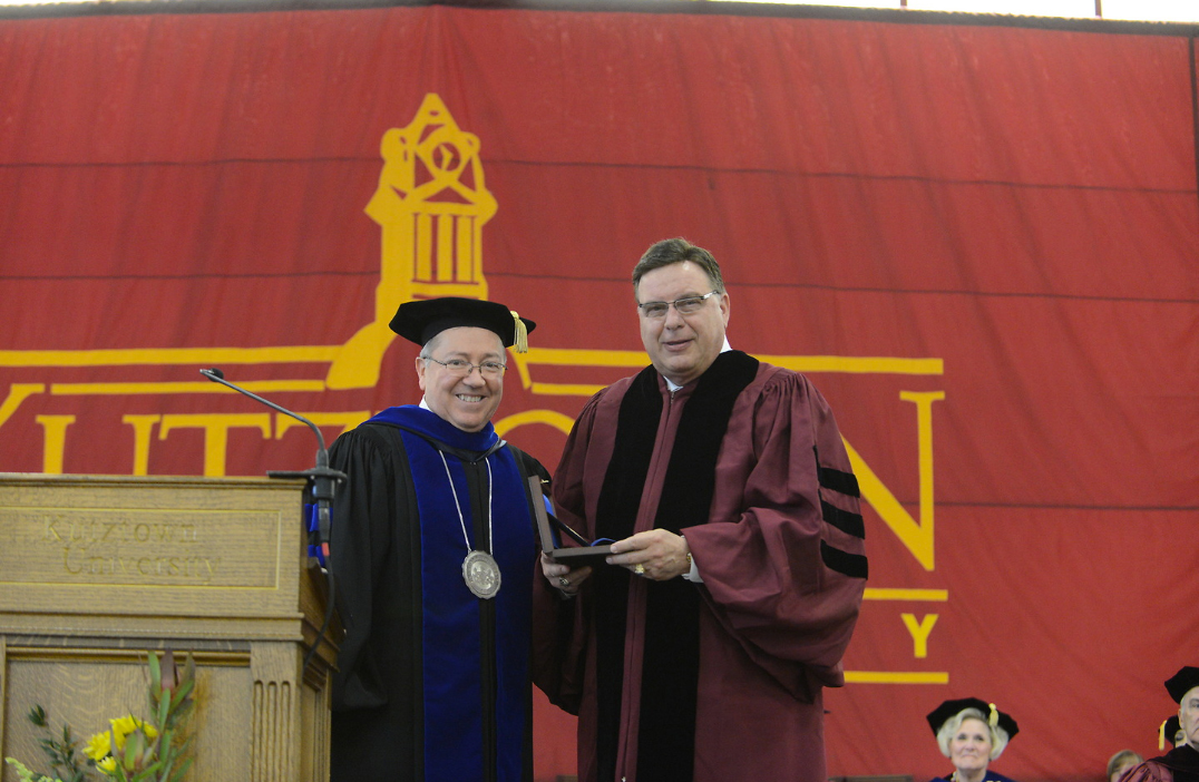 President F. Jaiver Cevallos (left) presents William Ribble (right) with the President's Medal
