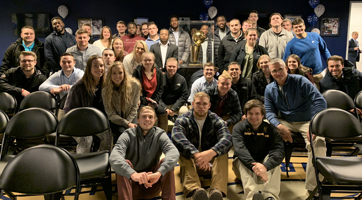Sport Management students and faculty in group shot with staff from the Philadelphia 76ers.
