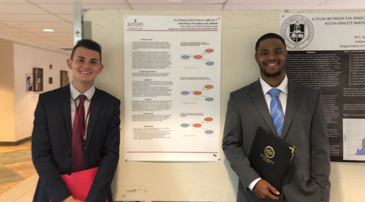 Deven Messner (Left) and Brandon McDonnaugh (Right) present their research.