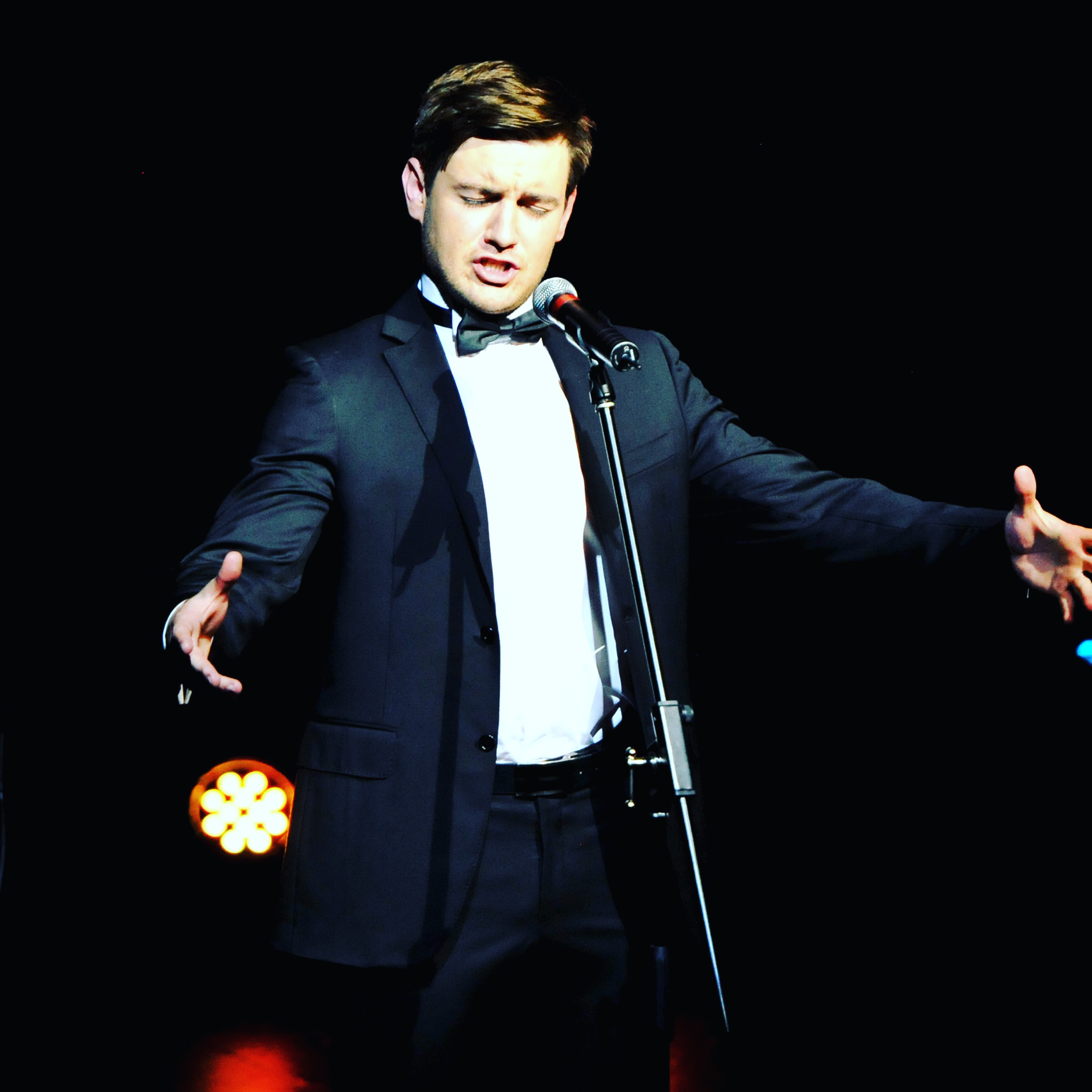 Emmet Cahill performing on stage