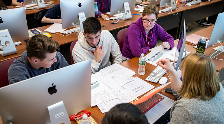 Kutztown University students, faculty, and alumni taking part in the Annual Communication Design Department Designation