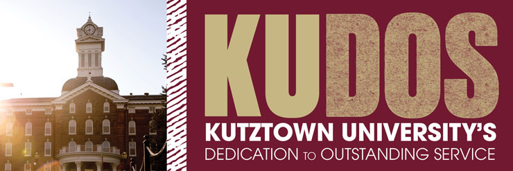 Rectangular image: Old Main Clock Tower is on the left with slight sun glare on left of building. The right side of the image are the words KU (gold type) DOS (gold speckled type), with Kutztown University's (white bold caps  under KUDOS) and Dedication to Outstanding Service (white caps under Kutztown University's)