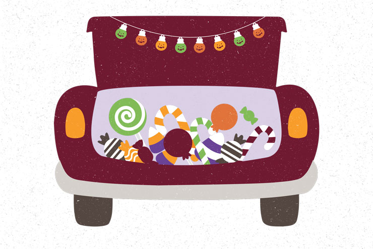 Clip art of the rear end of car with trunk open with a string of orange and green jack-o-lantern lights strung at the top. The trunk is full of various Halloween candies.