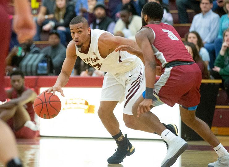 Kutztown University alum, Anthony Lee, pictured playing basketball while on the K U team.
