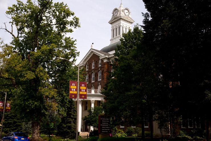 Exterior of Old Main with It's Good to be Golden banner.