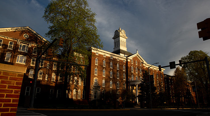 The evening sun shines on the front of Old Main.