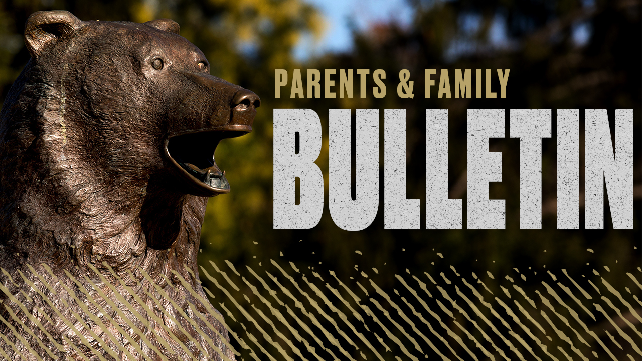 "Golden Bear Statue with ""Parents & Family Bulletin"""