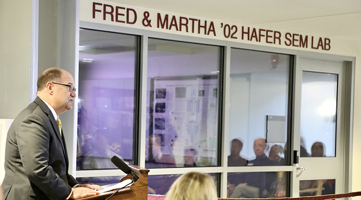 President hawkinson at podium in front of the SEM laboratory.