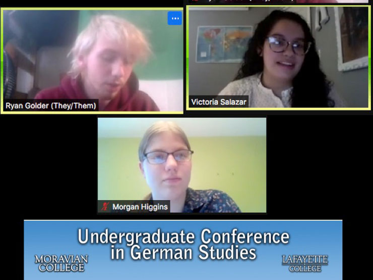 Zoom screenshot of three students. The words Undergraduate Conference in German Studies (white text) are in a light blue box at bottom of image. Moravian College (white text) are in bottom left of blue rectangle and Lafayette College (white text) are in bottom right corner.