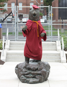 bear statue wearing a cap and gown