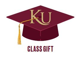 Maroon graduation cap with KU written on top and class gift written underneath the cap