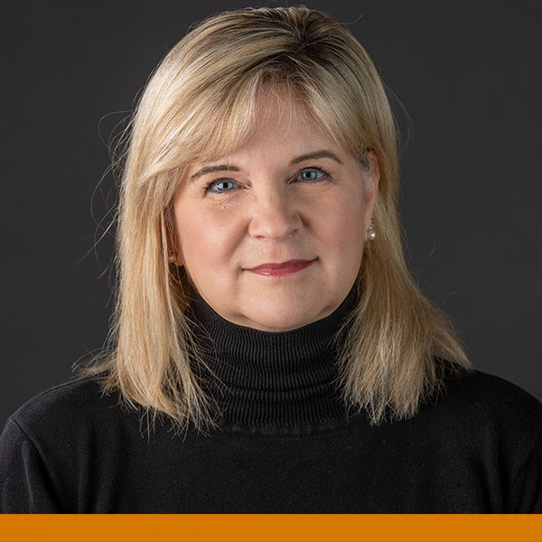 Artistic work, of a human head illustration with a city landscape and tree branches making up the area of hair