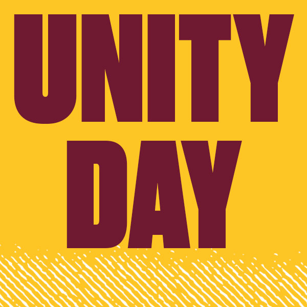 Spirit yellow background with maroon words Unity Day and a white burnish decoration on the bottom