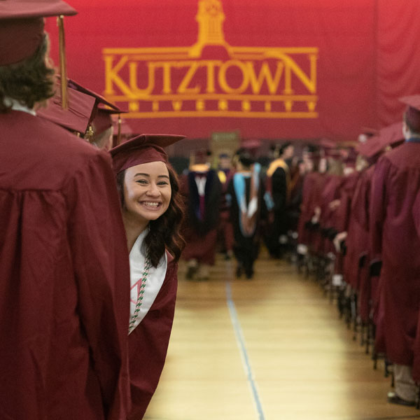 Student looks back at camera during commencement