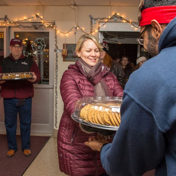 President and Mrs. Hawkinson deliver cookies to residence halls
