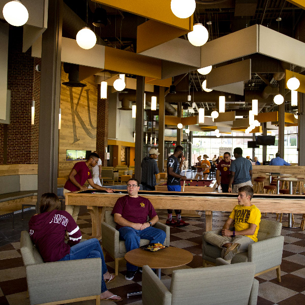 students relaxing in south dining hall