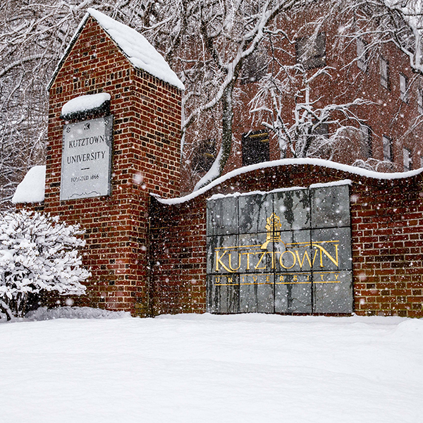 kutztown sign with snow falling