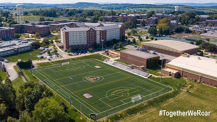 And arial view of the south side of campus from the field behind keystone hall through the back of Old Main.