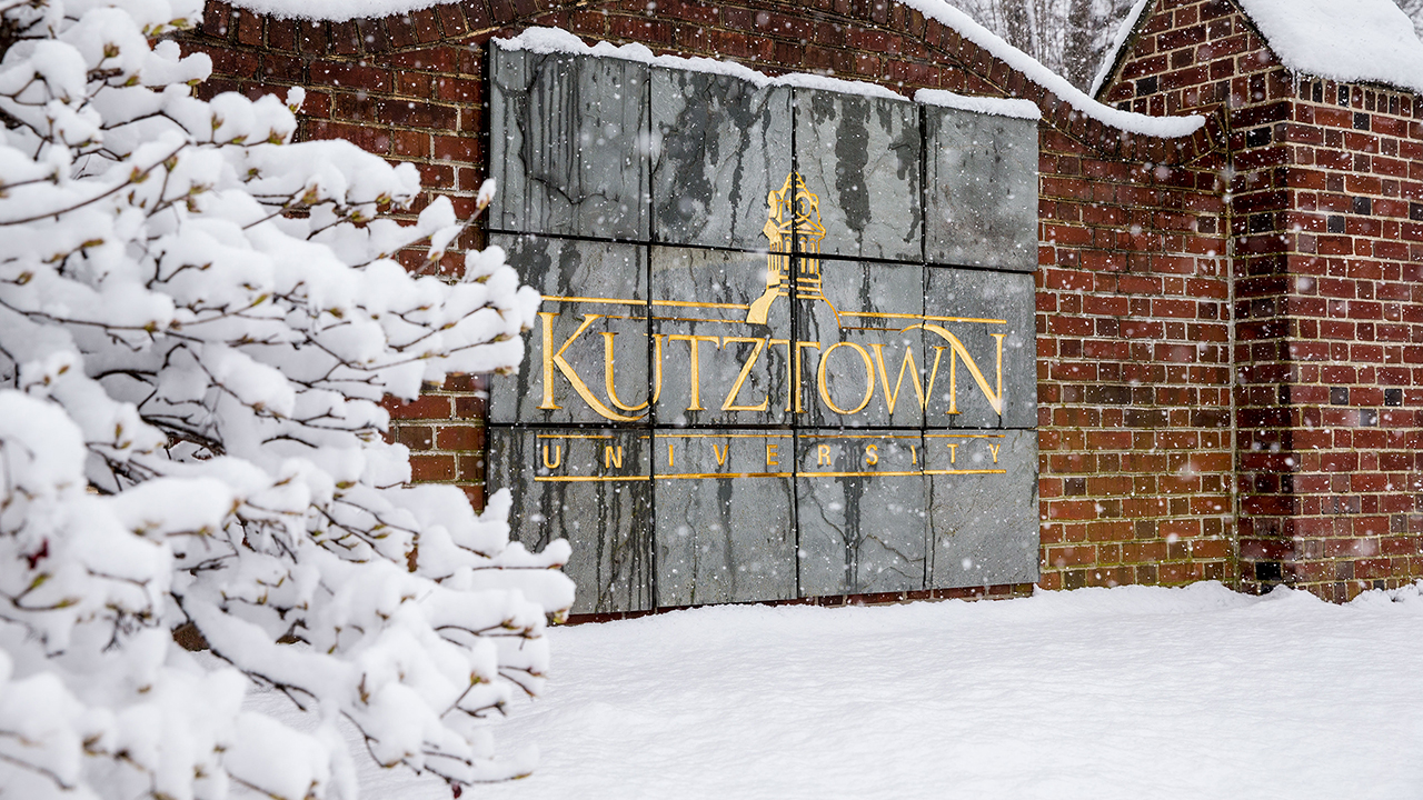 Kutztown University sign covered in snow
