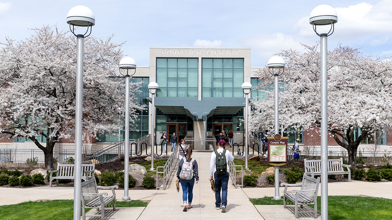 Students walking in front of Rohrbach Library