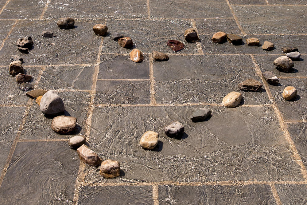 Alumni Plaza with Heart designed in stones of the fountian waters