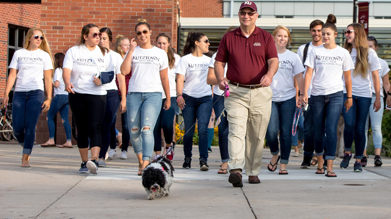 President Hawkinson on a walk with a group of students