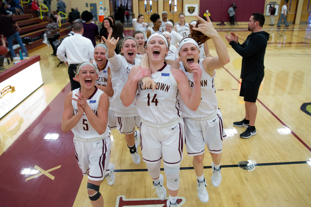 Women's Basketball players celebrate a victory